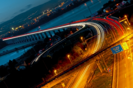 Long exposure of traffic in curve with red and white trails of light  photo