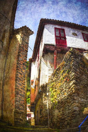 Alley in the village of Cudillero in Asturias, Spain photo
