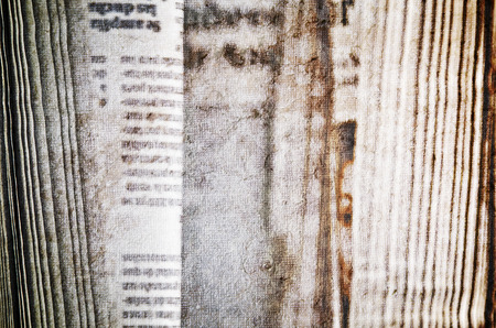 Closeup of rolled-up newspaper  photo