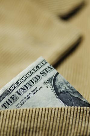 corduroy: corduroy jacket close up shot with One Dollar.