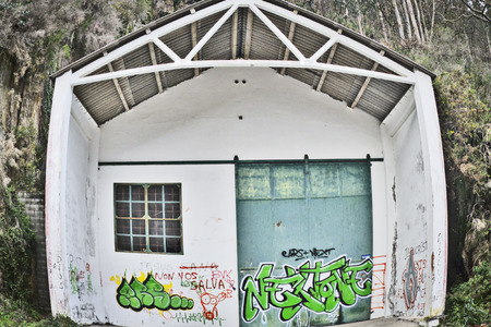abandoned warehouse: Facade of abandoned warehouse in the forest