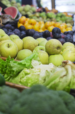 Colourful fruit and vegetable market stall in a rustic display
