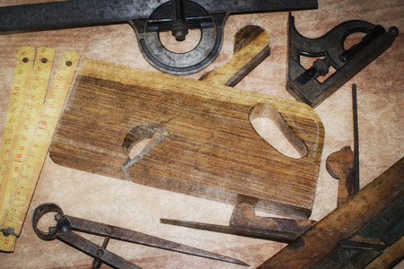 Old carpentry tools on a wooden table photo