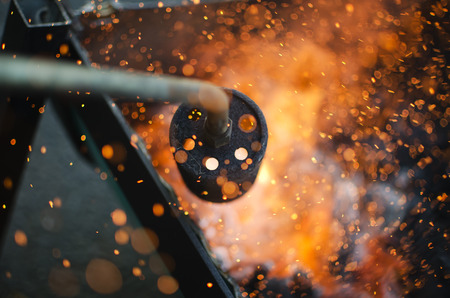 blowpipe: Ignition of the coal with a blowpipe Stock Photo