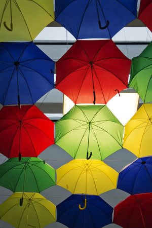 comercial: A comercial area decorated with umbrellas.