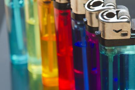 multicolored: Multi-colored cigarette lighters close up.