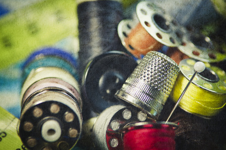 old spools: Old thread spools and thimble Stock Photo