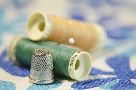 needlecraft product: Old thread spools and thimble Stock Photo
