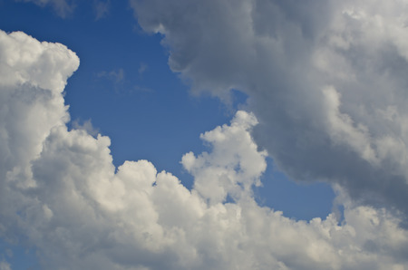 ozone layer: blue sky with white clouds in summer, textured effect. Stock Photo