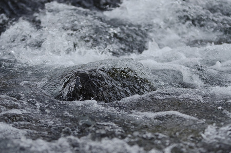 flowing water: Abstract flowing water river stone curves background Stock Photo