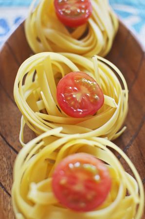 definite: Raw ribbon pasta with tomatoes.
