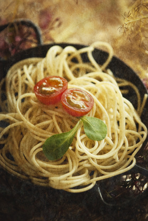 definite: A bowl of pasta with tomato