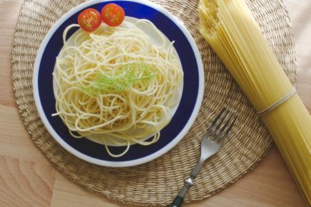 definite: Spaghetti-no sauce, on a plate.