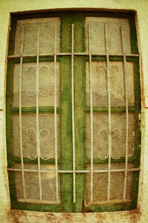 definite: Deformed window on the Peeling Facade Stock Photo