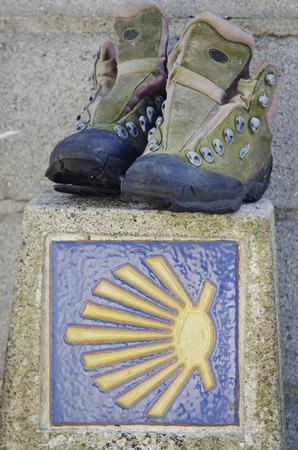 definite: Boots on a landmark of Camino de Santiago