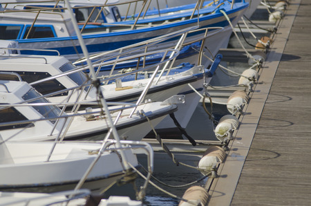 definite: Line of moored boats in a marina