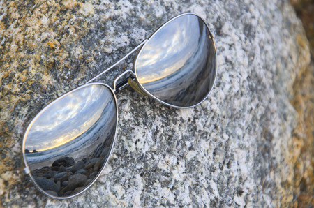 mediterranean countries: Sunset reflected on a sunglasses.
