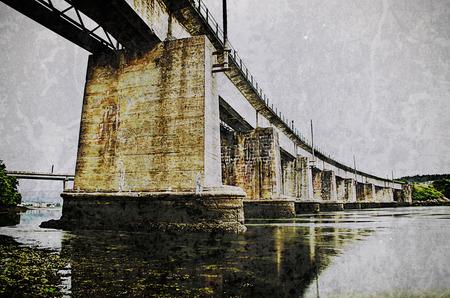 definite: Stone railway bridge on the coast in Ferrol- Spain Stock Photo