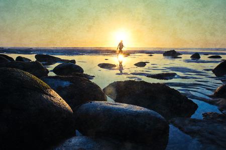 definite: Sunset on atlantic coast with human siluette.