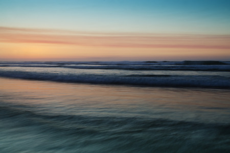 definite: Abstract waves in coast at sunset