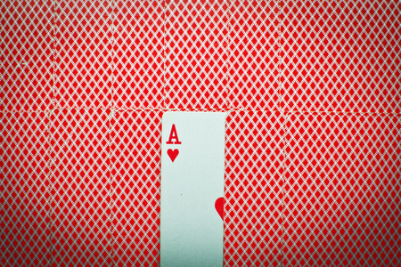 ace: Ace of Hearts looms between cards