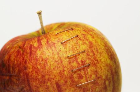 stapled: Stapled apple studio isolated on white background