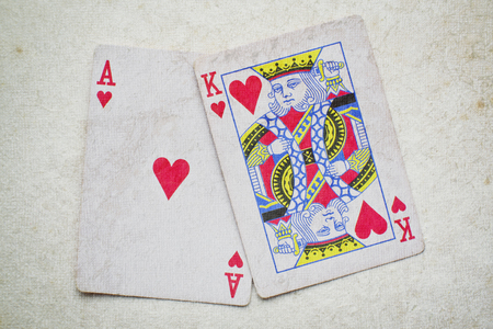 ace: hand of Ace, King on vintage background. Stock Photo