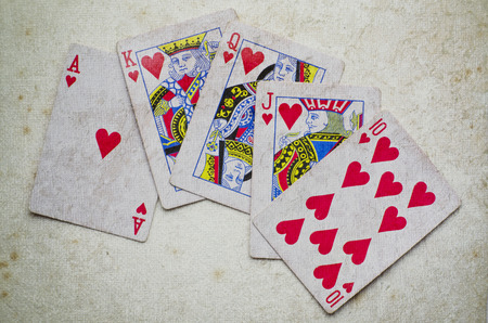 texas hold em: hand of Ace, King on vintage background. Stock Photo