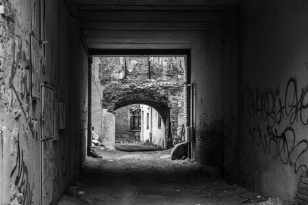 On the outskirts of the city, graffiti in the arch, black and white photo.