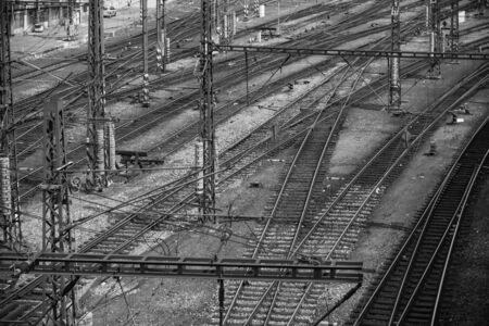 Multiple railway track switches. Industrial view. Transporting system. Symbolic black and white photo for choise, decision, separation, leadership qualities.