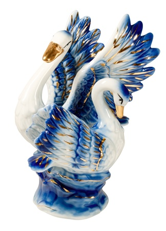 Two beautiful swan on a white background. Ceramics