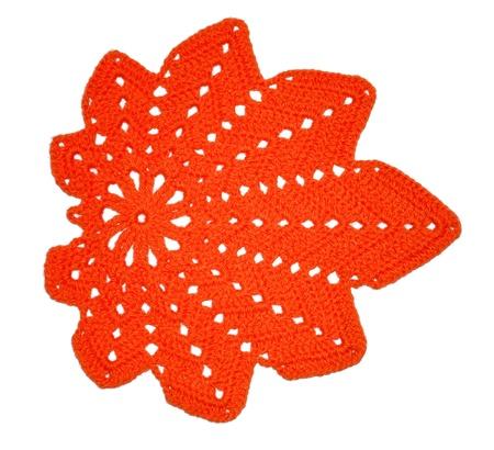 handiwork: Crochet leaflet of wool thread on a white background. Handiwork  Stock Photo