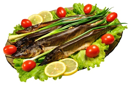 Smoked pike - elite beer snack. Serve with vegetables on a platter   photo