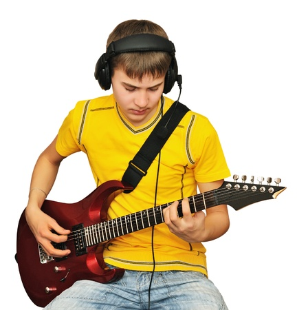 A teenager looks at a string electric guitar Stock Photo