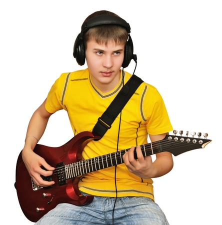 Young man playing electric guitar, looking to go public Stock Photo