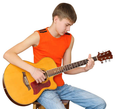 Teen chooses chords to a song. Learning to play classical guitar