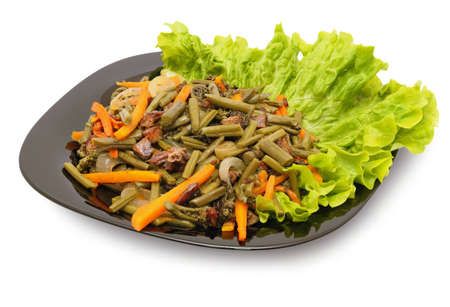 Fried bracken with meat, onions, carrots on a lettuce leaf. Dishes with ferns - the traditional food of the peoples of the Far East