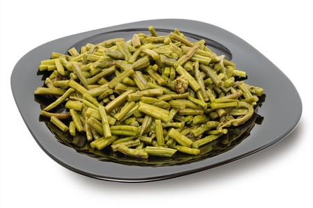 Canned pickled bracken - a common ingredient in Korean and Japanese national cuisine. Isolation circuit is saved to a file Stock Photo