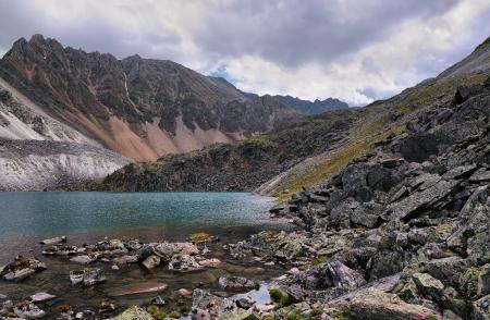 Beautiful alpine landscape with a mountain lake shore. Eastern Sayan. The Republic of Buryatia Stock Photo - 14894796