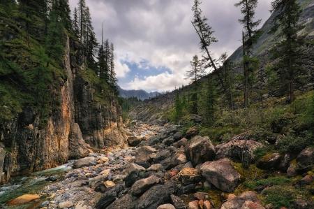 Rock in a small mountain river canyon. Eastern Sayan. Republic of Buryatia