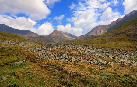 The path in the alpine tundra. Eastern Sayan. Republic of Buryatia Stock Photo - 15845856
