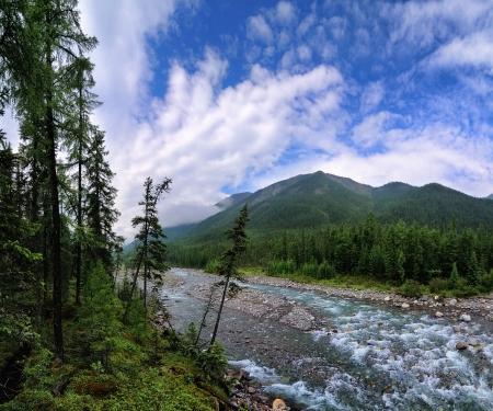 Beautiful sky above the mountain river. Shumak. Eastern Sayan. Republic of Buryatia Stock Photo - 16359636