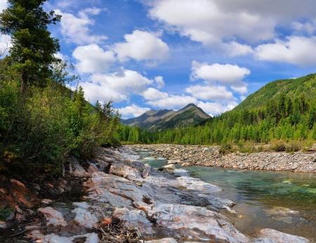 Beautiful sky with clouds over the mountain stream. Shumak. Eastern Sayan. Buryatia Stock Photo