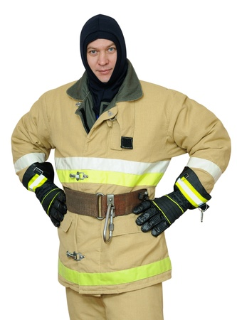 turnout gear: Firefighter stands arms akimbo. Isolated on white background