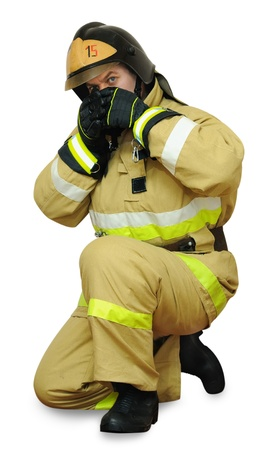 Fireman in a difficult situation hides her face from the heat to open flames Stock Photo