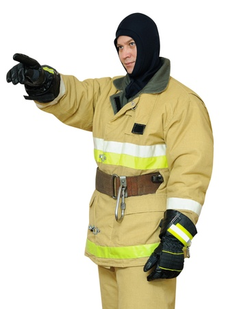 Firefighter points finger direction.Isolated on white background