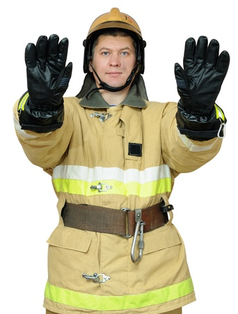 Fireman hand gestures instructs to stop the movement. Isolated on white background Stock Photo - 16613277
