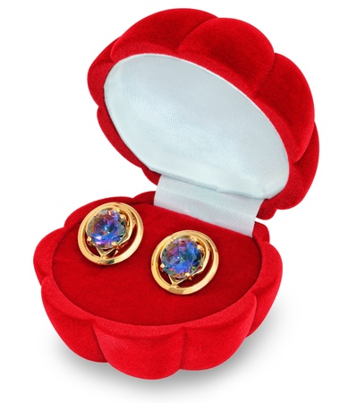 Gold earrings with large stones, rock crystal casket in the red-shell photo