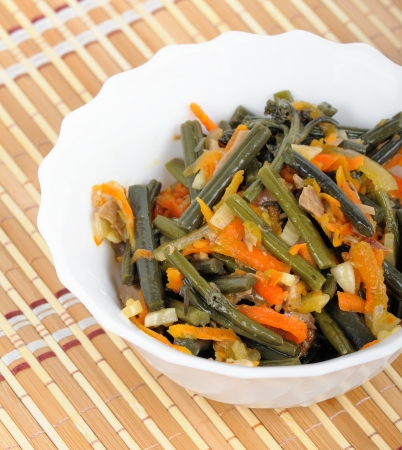 Cold appetizer of bracken fern in white salad bowl Stock Photo