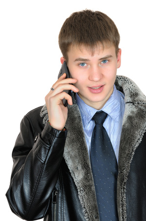 Young businessman talking on mobile phone. Isolated on white